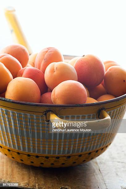Fresh apricots in metal colander