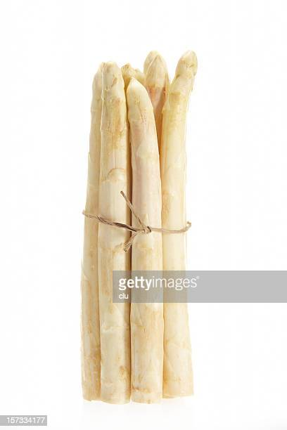 Fresh asparagus batch standing vertical on white background