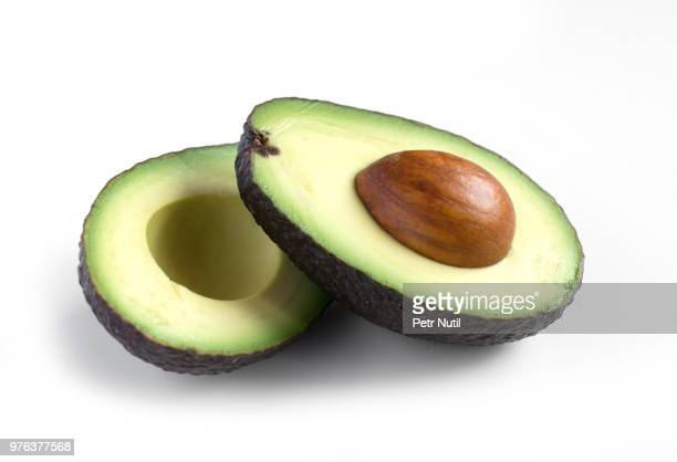 A fresh avocado cut in half