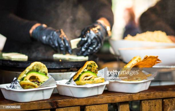 fresh avocado wraps for sale at vegetarian stall at food market - food state stock pictures, royalty-free photos & images