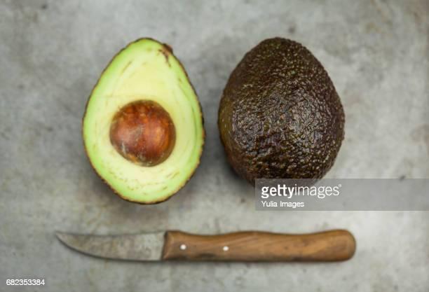 Fresh avocados in metal pan