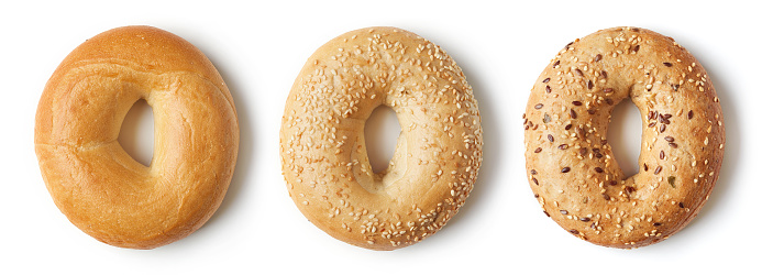 Fresh bagels on white background, from above 1059647686