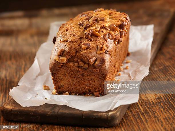 fresh baked banana bread - wax paper stock photos and pictures