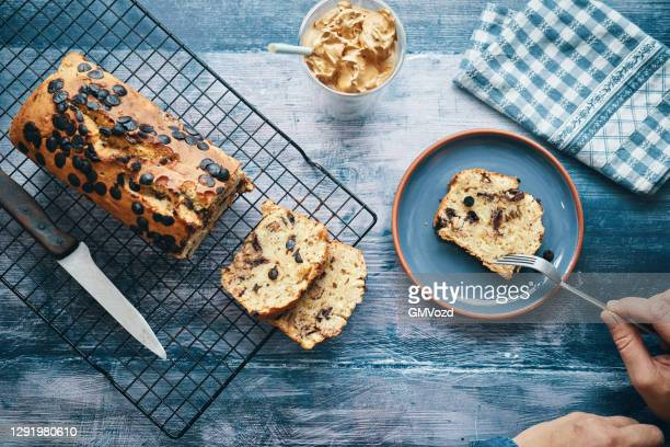 fresh baked banana bread served with dalgona coffee - dalgona stock pictures, royalty-free photos & images