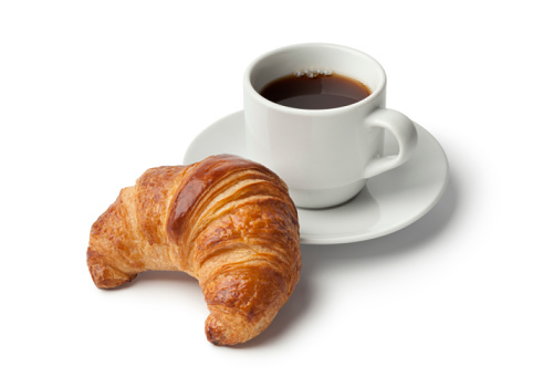Fresh baked croissant and a cup of coffee 590259092
