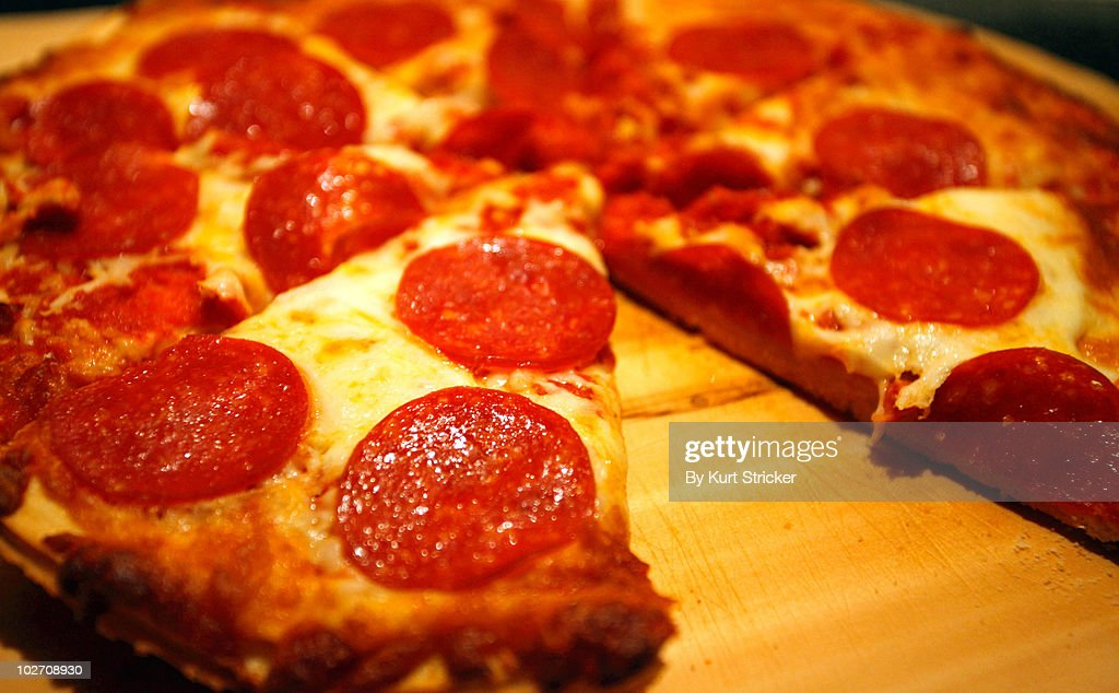 Fresh Baked Pizza On A Wooden Board : Stock Photo