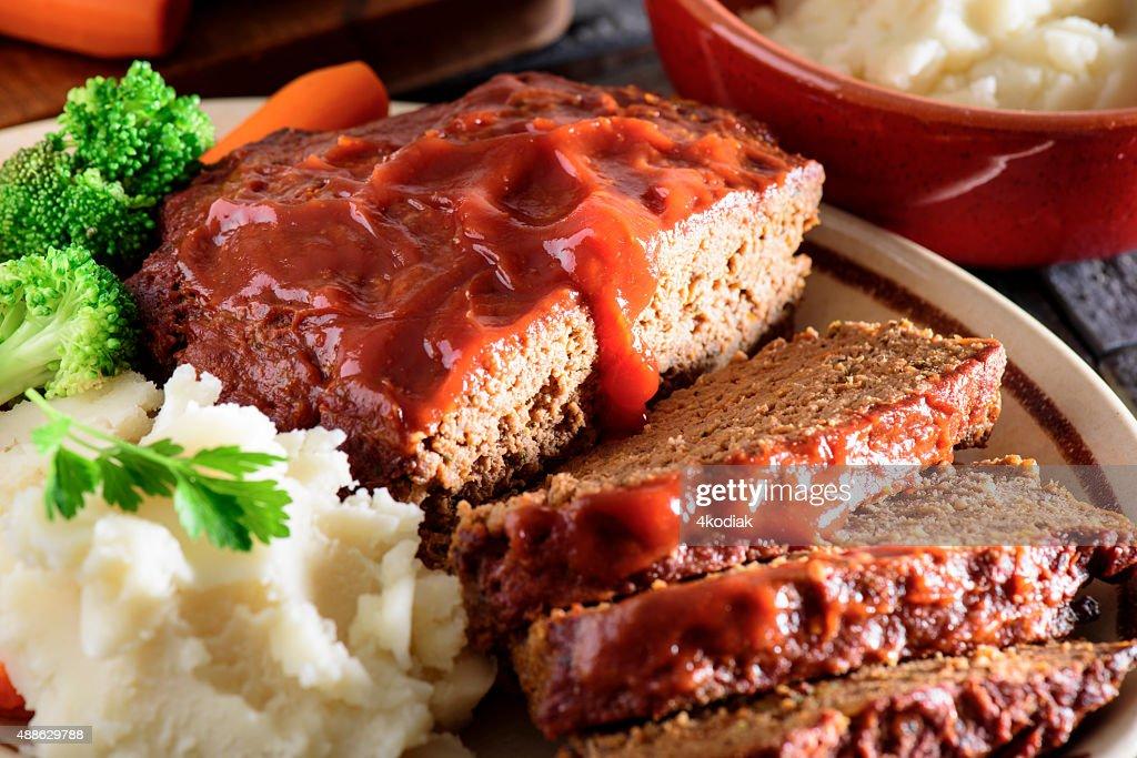 Fresh baked tomato glazed meatloaf served with mashed potato : Stock Photo