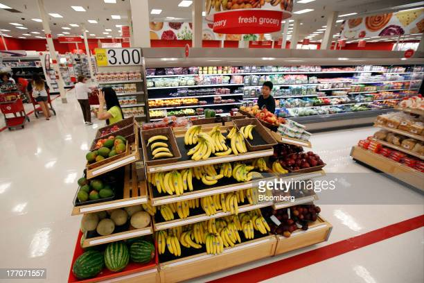 Fresh bananas and other produce for sale in the grocery section inside the Target Corp Store in Torrance California US on Tuesday August 20 2013...