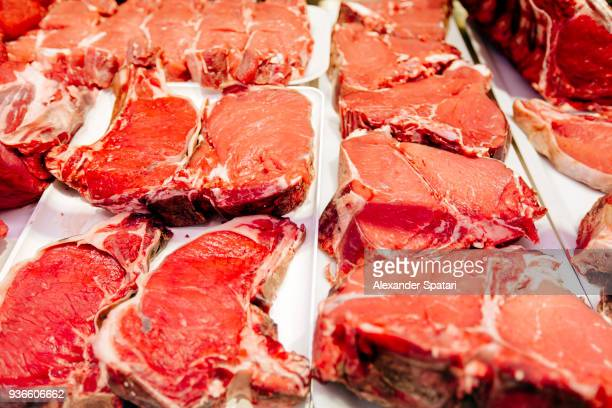 fresh beef steaks meat on a market stall - red meat stock pictures, royalty-free photos & images