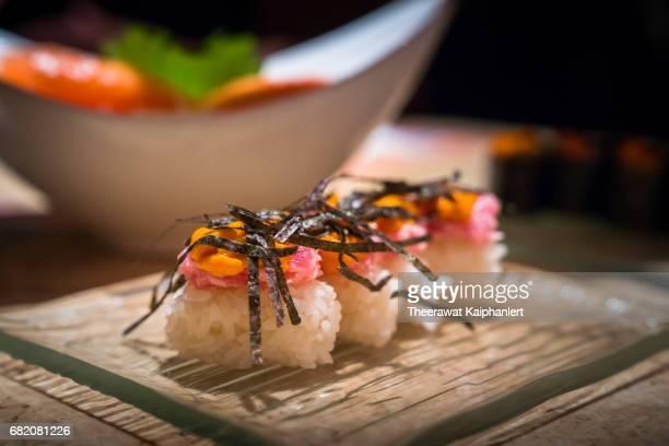 Fresh beef sushi nigiri topped with uni
