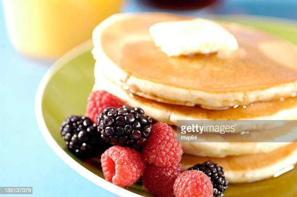 Fresh berries finish off a buttery, syrupy stack of pancakes