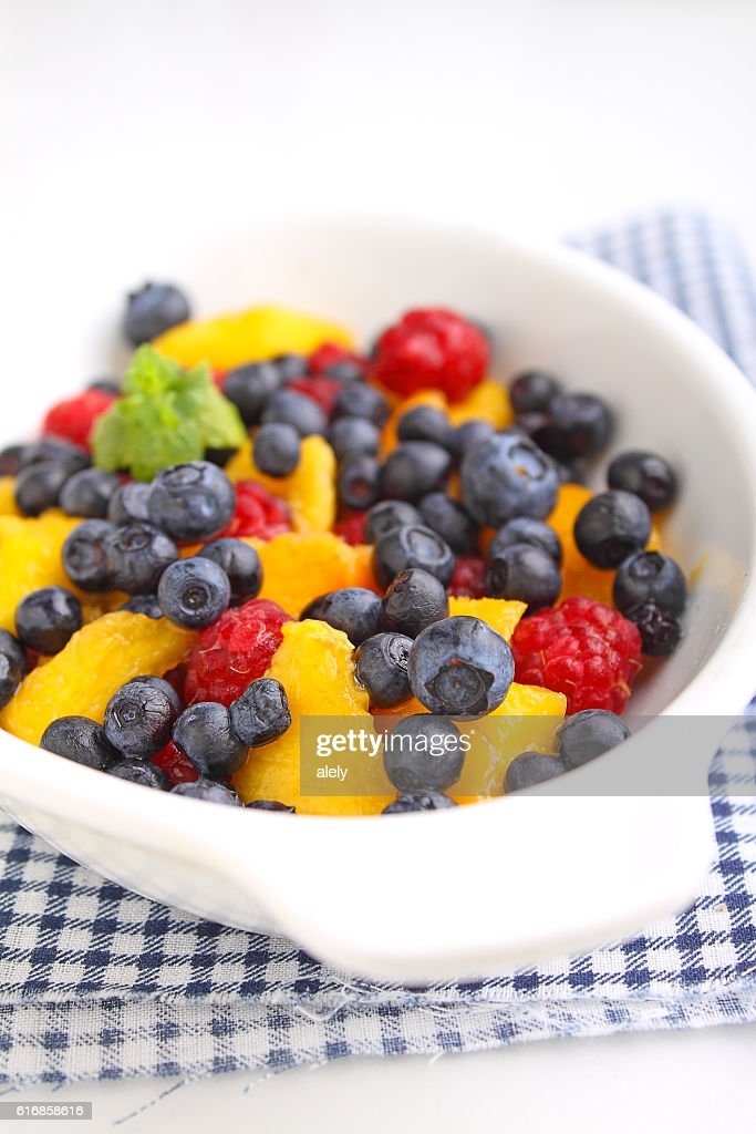 fresh berries in a white plate : Stock Photo