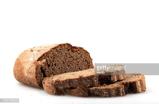fresh black sliced bread on white background - loaf of bread stock pictures, royalty-free photos & images