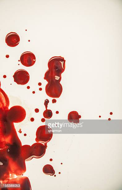 fresh blood droplets red on white background 4 - bloody gore stock pictures, royalty-free photos & images
