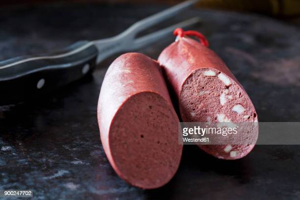 Fresh blood sausage on dark background