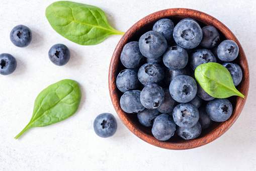 Fresh blueberries in bowl on white background, top view 953628196