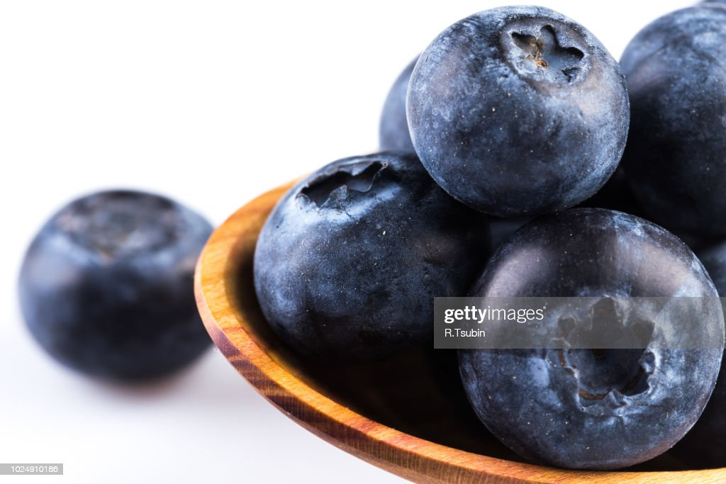 Fresh Blueberries In Wooden Spoon On White Background Stock