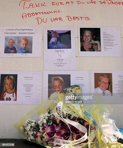 A fresh bouquet lies under the pictures of Philip and Alexander Nystrom Saga Kalm Anna Roland Patrik and Charlotta Svensson who were victims of last...