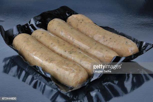 Fresh bratwurst sausages sealed in a vacuum sealed container