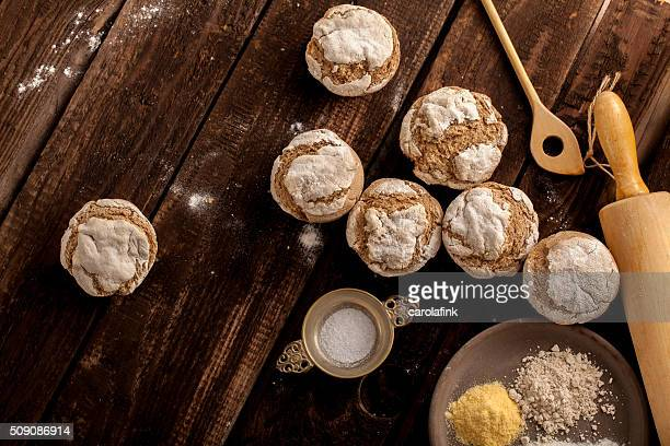 fresh bread buns on wooden board - carolafink stock photos and pictures
