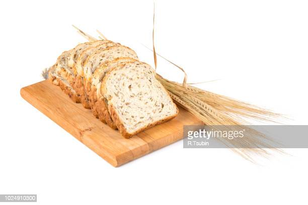 fresh bread on wooden plate and wheat on white - 全部 ストックフォトと画像