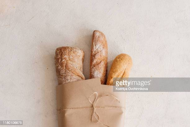fresh bread on wooden table. top view with space for your text - 一斤 ストックフォトと画像