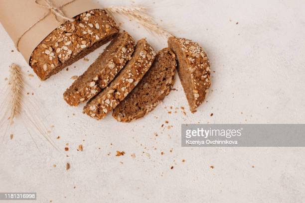 fresh bread on wooden table. top view with space for your text - wholegrain stock pictures, royalty-free photos & images