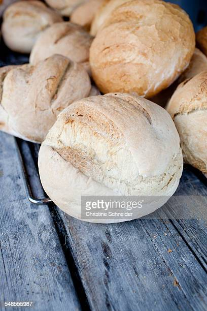 Fresh bread rolls on top of picnic bench, South Tyrol, Italy
