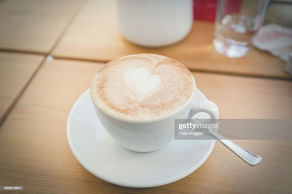 fresh brewed cappuccino coffee with milk in a white cup : Stock-Foto