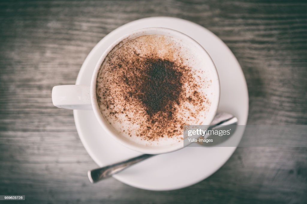 fresh brewed cappuccino coffee with milk in a white cup : Stock Photo