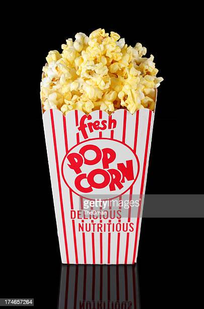 fresh buttered popcorn in retro red striped theatre box - popcorn stock pictures, royalty-free photos & images