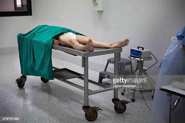 A fresh cadaver is prepared to have skin samples taken for research and training purposes at the Anatomy Lab of Chulalongkorn University on July 7...