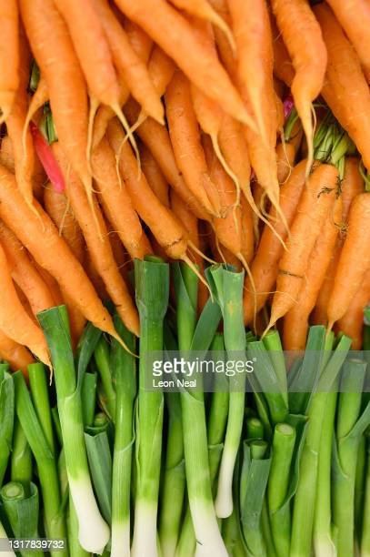 Fresh carrots and onions are seen in the kitchens at The Ritz London on May 13, 2021 in London, England. After closing its doors in the middle of...