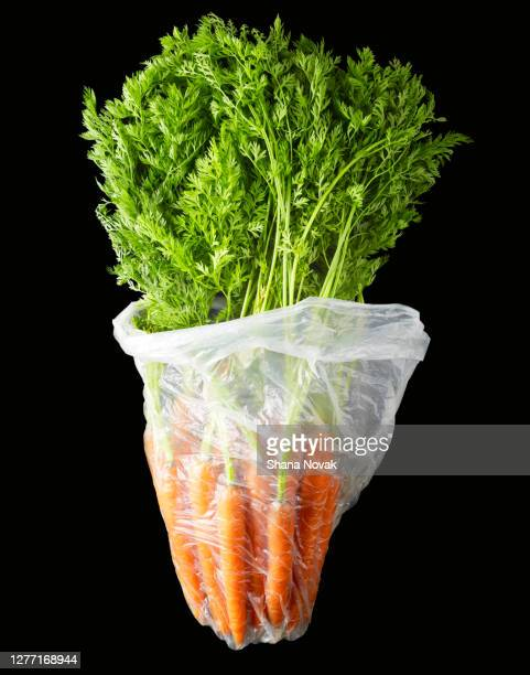 "fresh carrots in a plastic produce bag - ""shana novak"" stock pictures, royalty-free photos & images"