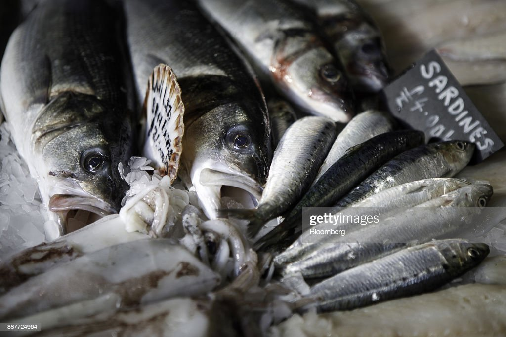 Fresh catches of sardines and wild sea bass sit on display at the Trelawney Fish & Deli fishmongers in Newlyn, U.K., on Tuesday, Nov. 28, 2017. Prime Minister Theresa May will pull Britain out of the 1964 London convention that allows European fishing vessels to access waters as close as six to twelve nautical miles from the U.K. coastline. Photographer: Annie Sakkab/Bloomberg via Getty Images