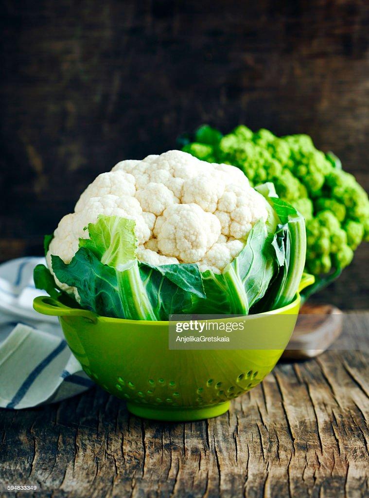 Fresh cauliflower in a colander : Stock Photo