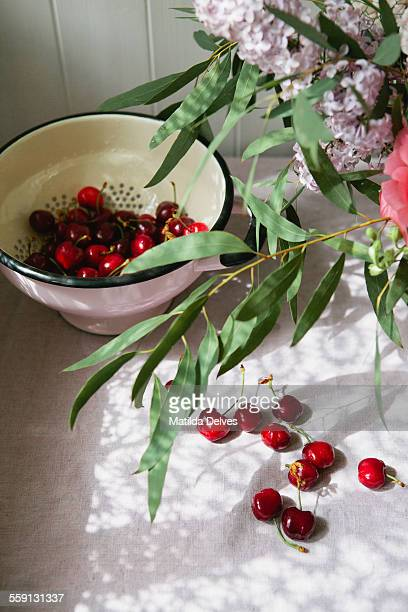 Fresh cherries and an informal bunch of flowers