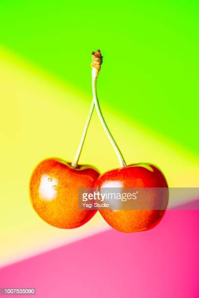 Fresh cherry on colorful background
