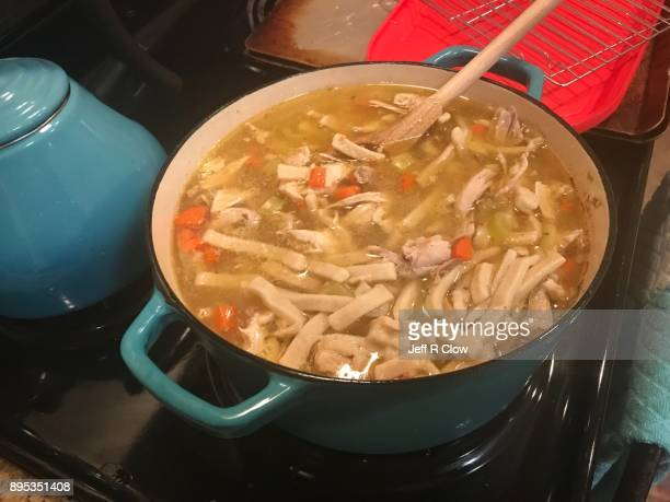 fresh chicken soup on the stove 3 - chicken soup stock photos and pictures