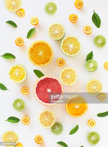 fresh citrus fruit slice design pattern background. - orange fruit stock photos and pictures