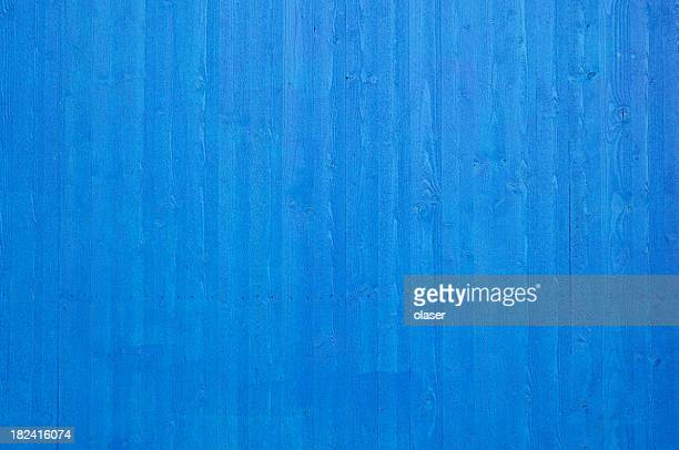 Fresh clean newly painted blue wooden plank wall