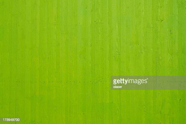 Fresh clean newly painted green wooden plank wall