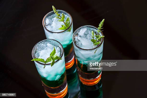 fresh cocktail with mint liqueur in glasses - vodka stock pictures, royalty-free photos & images