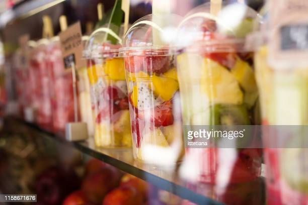 fresh colorful fruit salad in plastic packaging on street market - packaging stock pictures, royalty-free photos & images