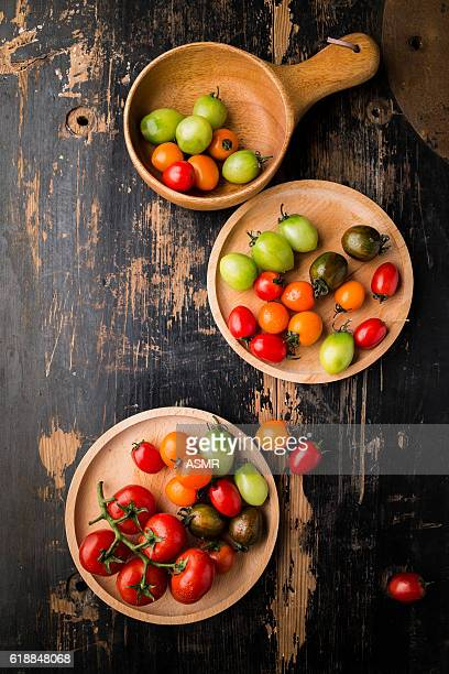 Fresh Colorful tomatoes on wooden table