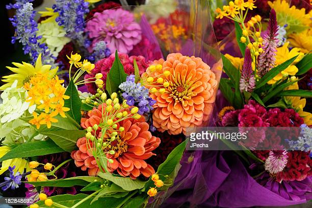fresh colorful variety flowers for sale at outdoor market - bouquet stock pictures, royalty-free photos & images