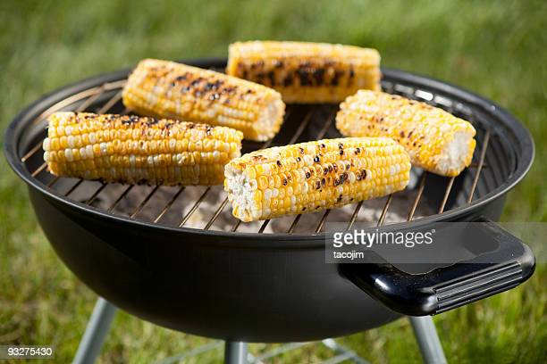 Fresh corn on the cob on a charcoal grill