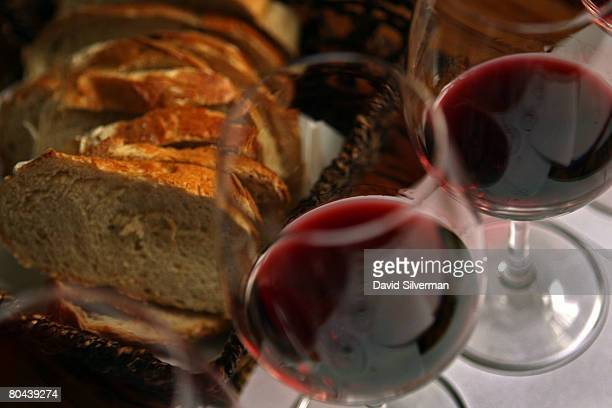 Fresh country bread and red wine are served with lunch at the Carmella Banahela bistro on March 25 2008 in Tel Aviv Israel World food prices are...