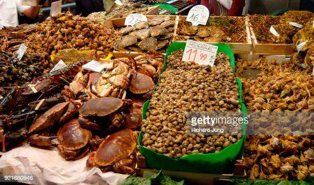 Fresh crab, lobster, prawns, cockles for sale at Boqueria market in Barcelona, Spain
