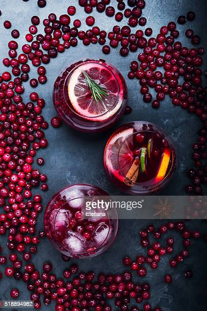 Fresh cranberry juice cocktail ripe cranberries on grey background viewed from above